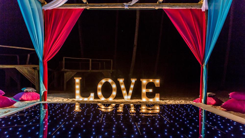 Illuminated dance floor with LOVE sign