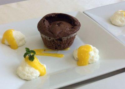Chocolate fondant, champagne mousse, mango sauce